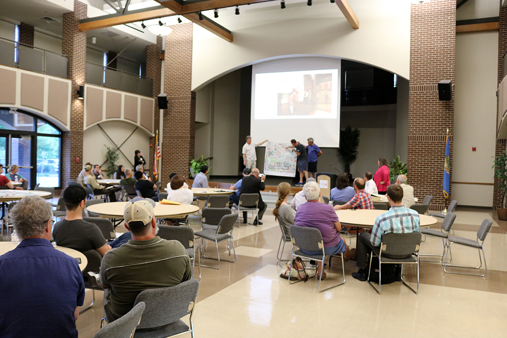 People gathered for a community planning meeting